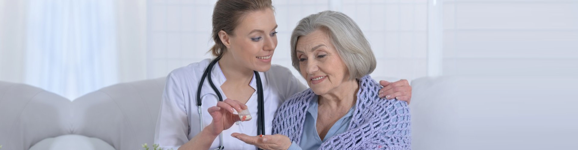 psychiatrist giving medication to patient